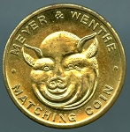Meyer & Wenthe advertising Flipping coin, Pig's Head - Pig's Tail