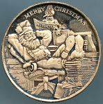 Merry Christmas - Santa Resting with his feet on the books of Boys and Girls names - 1 oz. .999 Silver with Clamshell Gift Box
